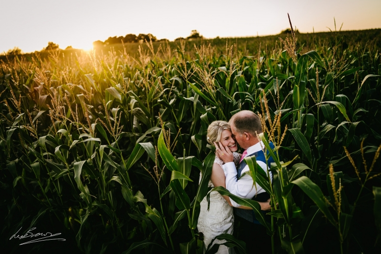 the couple in the cornfield at sandhole oak barn