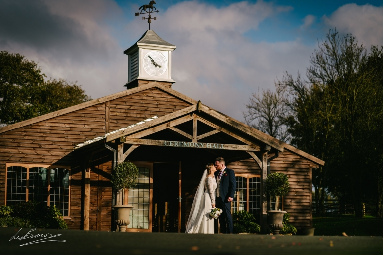 the couple outside the ceremony room at colshaw hall