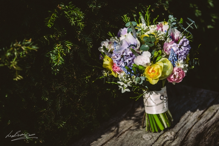 A floral bouquet by green earth flowers