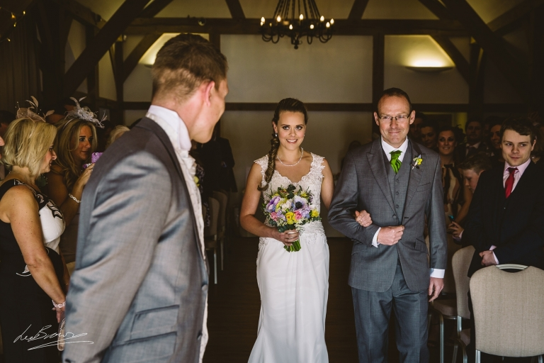 the bride walking up the aisle at sandhole oak barn